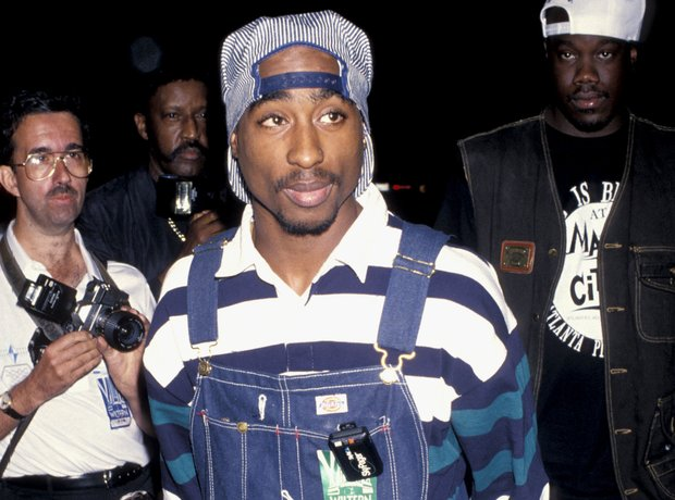 Tupac Shakur wearing denim dungarees