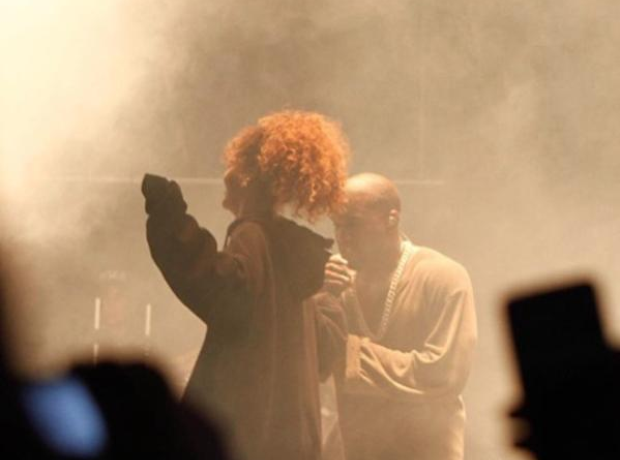 Rihanna and Kanye West perform on stage