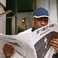 Image 8: Skepta reading newspaper