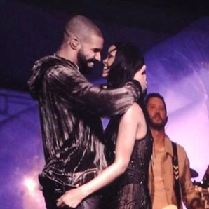 Rihanna and Drake hugging on stage