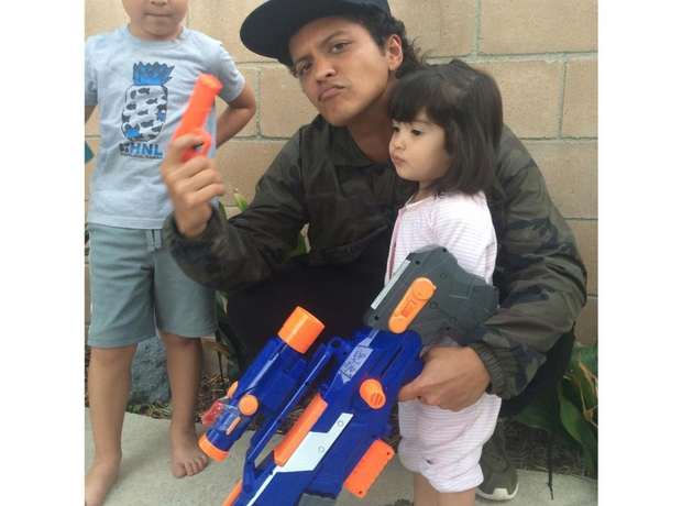 Bruno Mars poses with his kids after Nerf Gun war