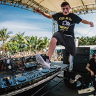 Martin Garrix jumping on stage