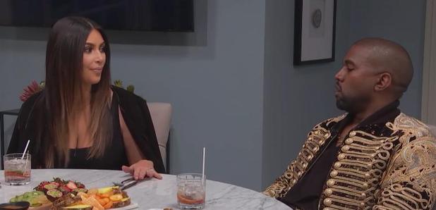 Kanye West and Kim Kardashian sat around a table