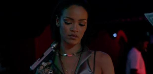Rihanna holding gun