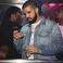 Image 10: Drake Looking At Phone