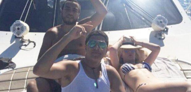 Iggy Azalea and French Montana on a yacht